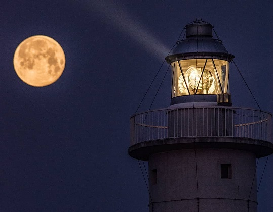 The wonderful photo of the moon and the lighthouse